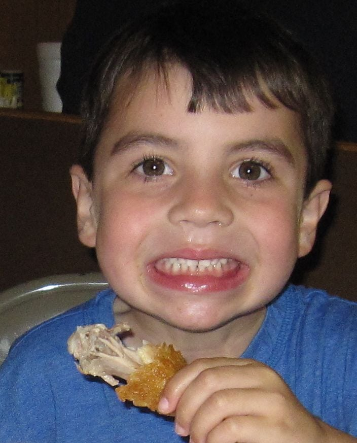 Kid eating Fried Chicken