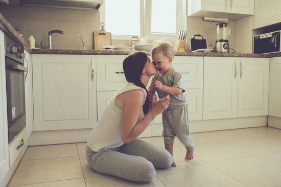Toddler giving mommy a kiss.