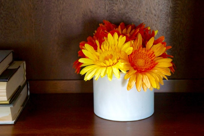 Orange and Yellow flowers on Styled Bookcase - Mommacan.com