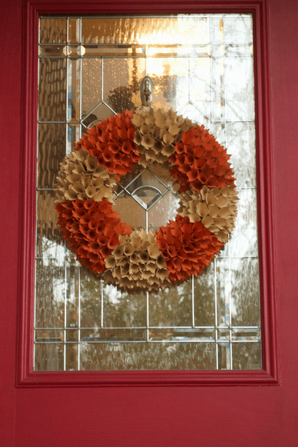 Choosing the right color combination adds just the right pop to a fall porch setting.