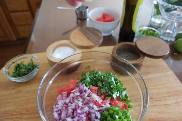 Jazzing up the watermelon salsa with some salt and pepper.