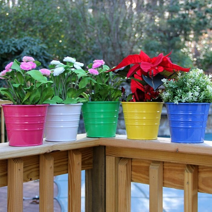 Grab these colorful metal buckets to add a dash of color to your summer patio.