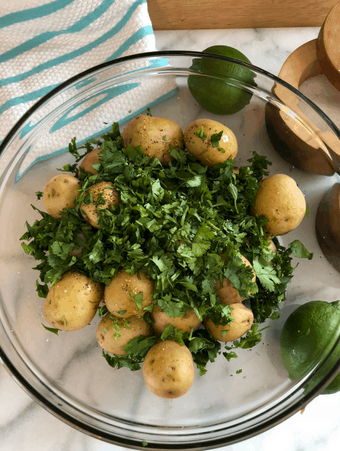 Simple ingredients of cilantro, lime, olivie, and new potatoes make this dish amazing!