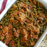 Southern Crack Smothered Green Beans - These Old Fashioned Green Beans with Bacon are delicious. Baked with a sweet sauce and crispy salty bacon and green beans this recipe makes a perfect combination and will feed a crowd! #greenbeans #southern #bacon