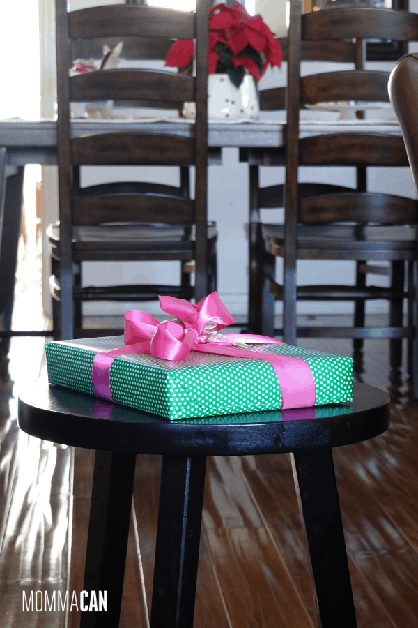 Christmas Home tour with wrapped bright green and pink present on wooden stool. I am in love with happy greens and pinks to wrap up Christmas gifts!