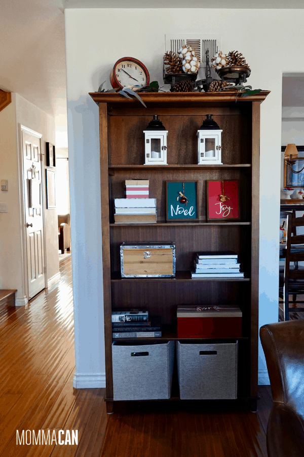Christmas styled bookcase with white lanterns and cotton