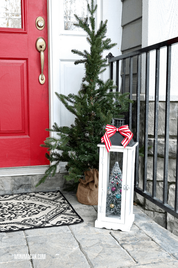 Christmas Front Entrance with White Lantern, red and white striped bow. Christmas is so easy when you don't over due design!