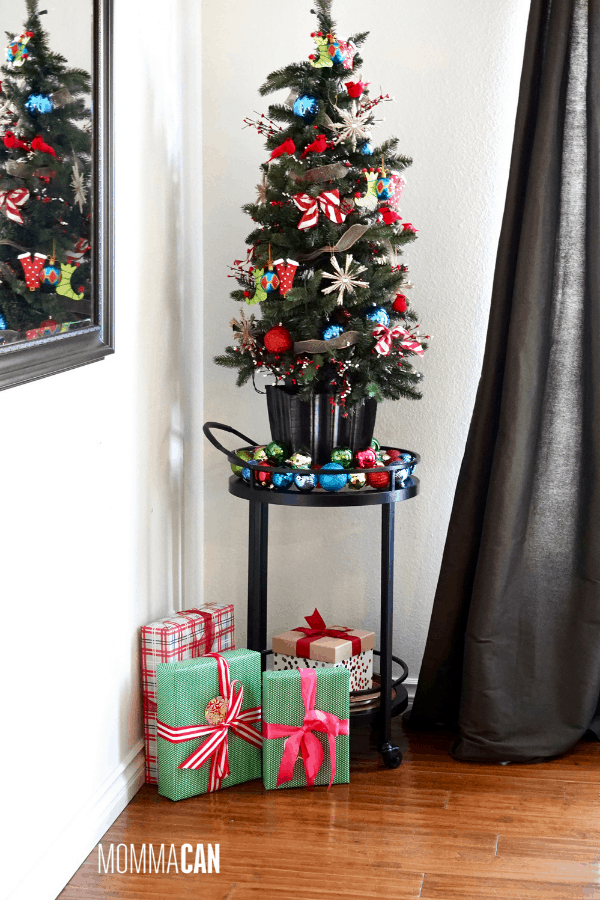 Small Decorated Red, Blue and Green Joy Christmas Tree in Christmas Holiday Home Tour Dining Room