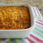 Southern Jiffy Cornbread Pudding Recipe is an easy and delicious side dish for holidays and family gatherings that feeds a crowd! We love serving it with pulled chicken and gravy and a good helping of green beans. A family favorite that is perfect for Thanksgiving, Christmas and any other day just for good eating.#jiffy #cornbread #pudding #recipes