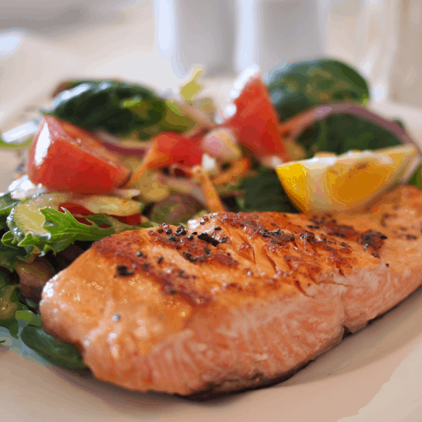 Fresh baked salmon with lettuce salad