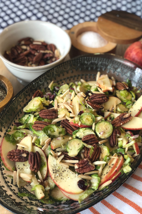 Shaved Brussels Sprouts Apple Cranberry Salad Apple Cranberry Salad with a maple vinairgrette and yummy toasted nuts and cranberries.