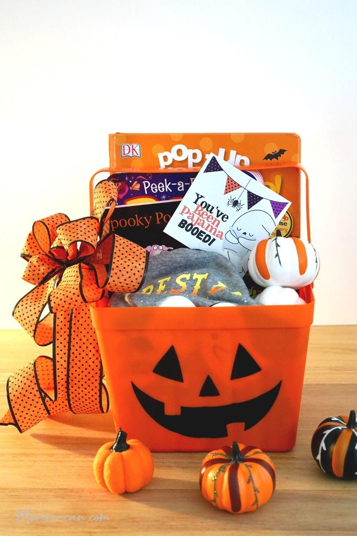 Halloween Pajama Boo Buckets with pumpkins and books.